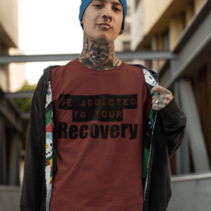 Man wearing tee shirt that says Stay Addicted To Your Recovery.